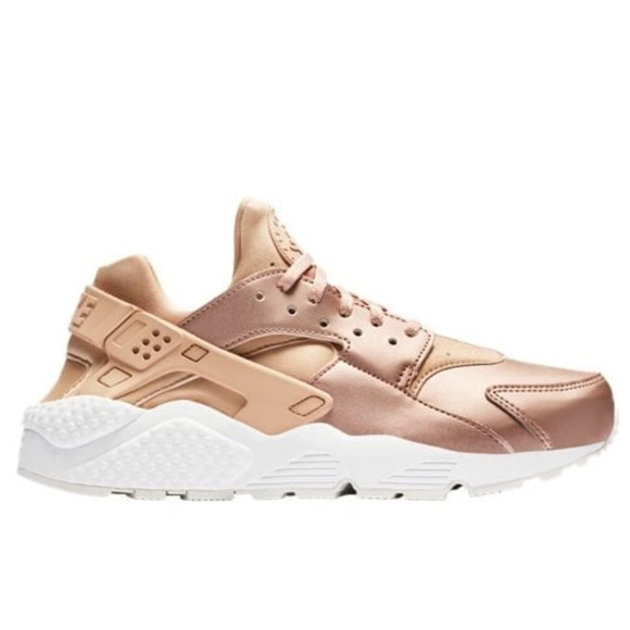 new style a96ca fea78 Nike womens huarache metallic rose gold sneakers